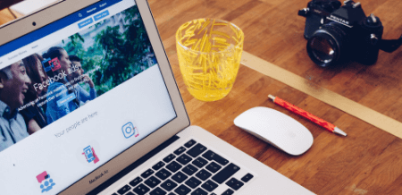 Facebook Advertising on Laptop and a Drink