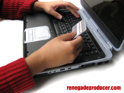 Image of someone making an online credit card payment with a laptop.